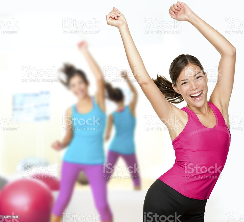 Women in pink and blue doing a Zumba dance stock photo