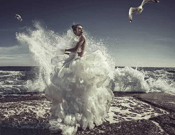 women in plastic bag dress - wedding fashion stock photos and pictures