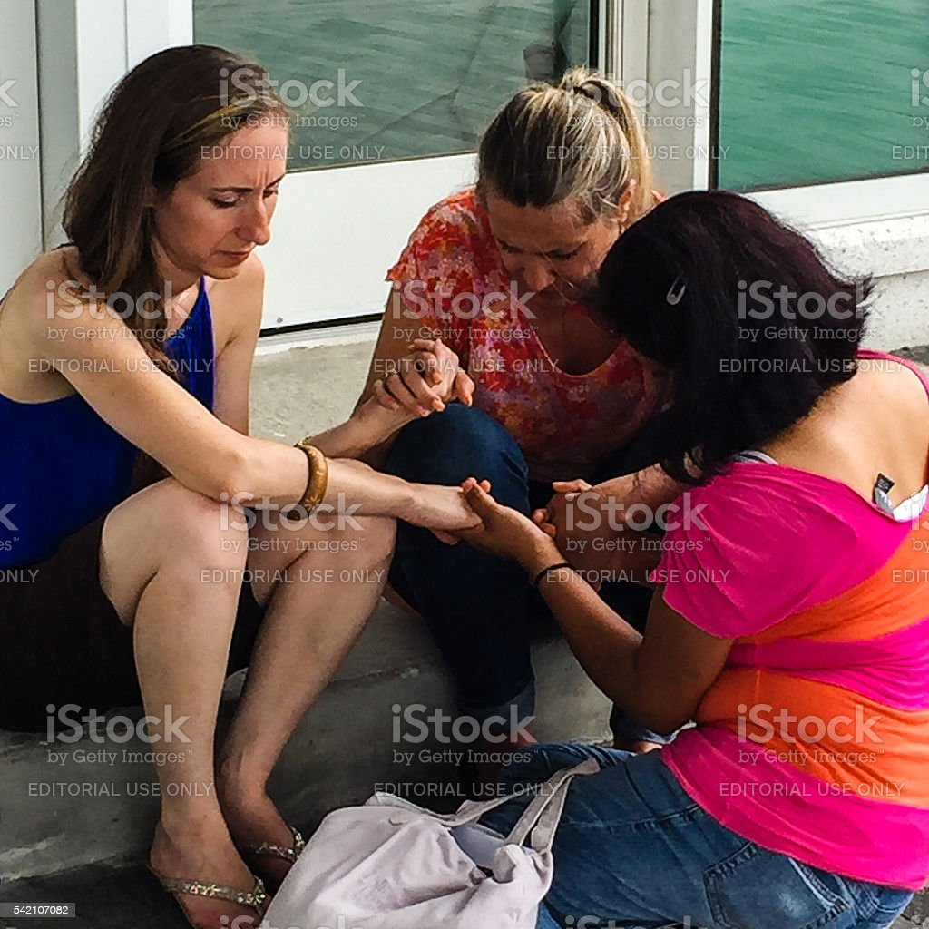 Women in Prayer Holding Hands stock photo