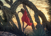 women in red at joshua tree in Arizona