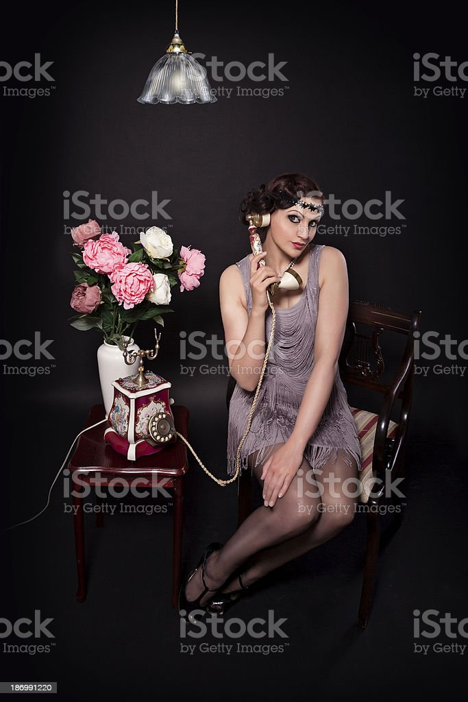 Women in retro style dress on the phone stock photo