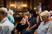 Women in senior congregation praying together