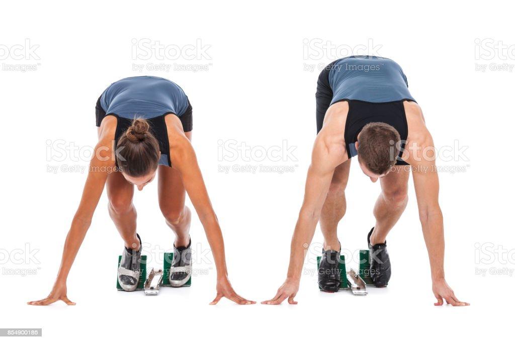 Women in Sport - sprint start isolated on white stock photo