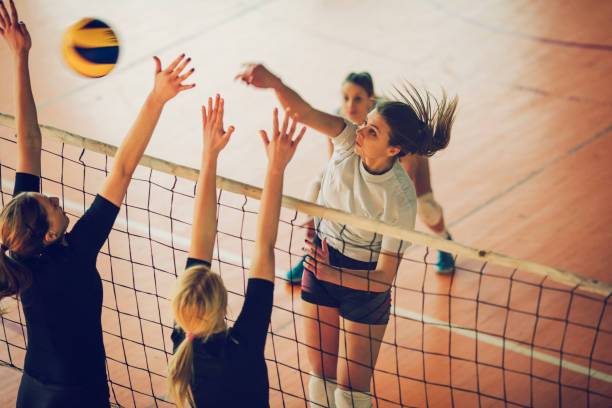 women in sport - volleyball - volleyball stock photos and pictures
