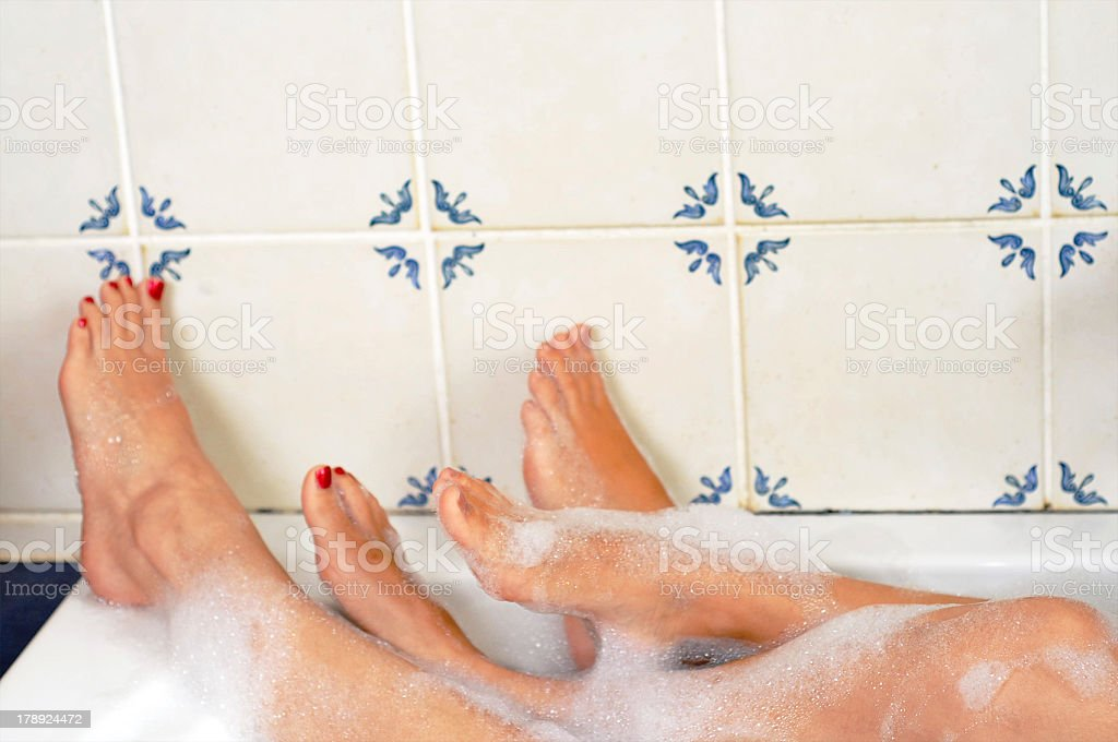 Women in the bath together stock photo