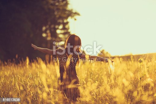 istock women in the evening sky in a meadow 816513638