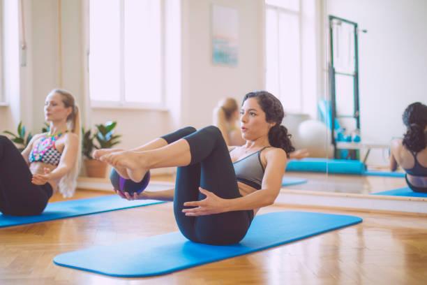 women in the fitness center - metodo pilates foto e immagini stock