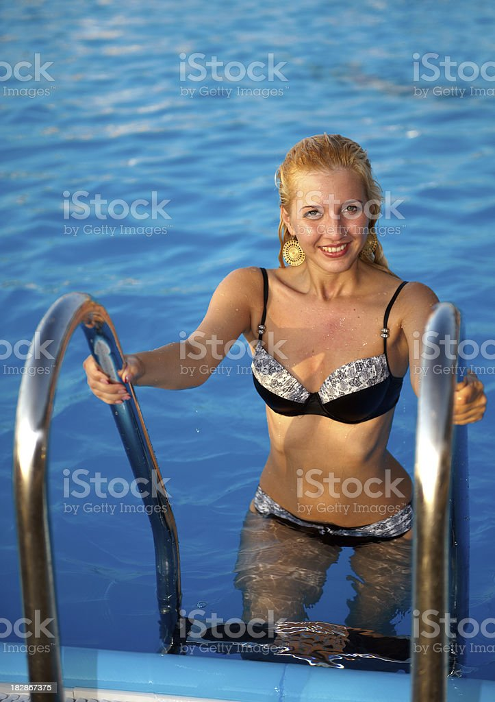 Women in the pool stock photo