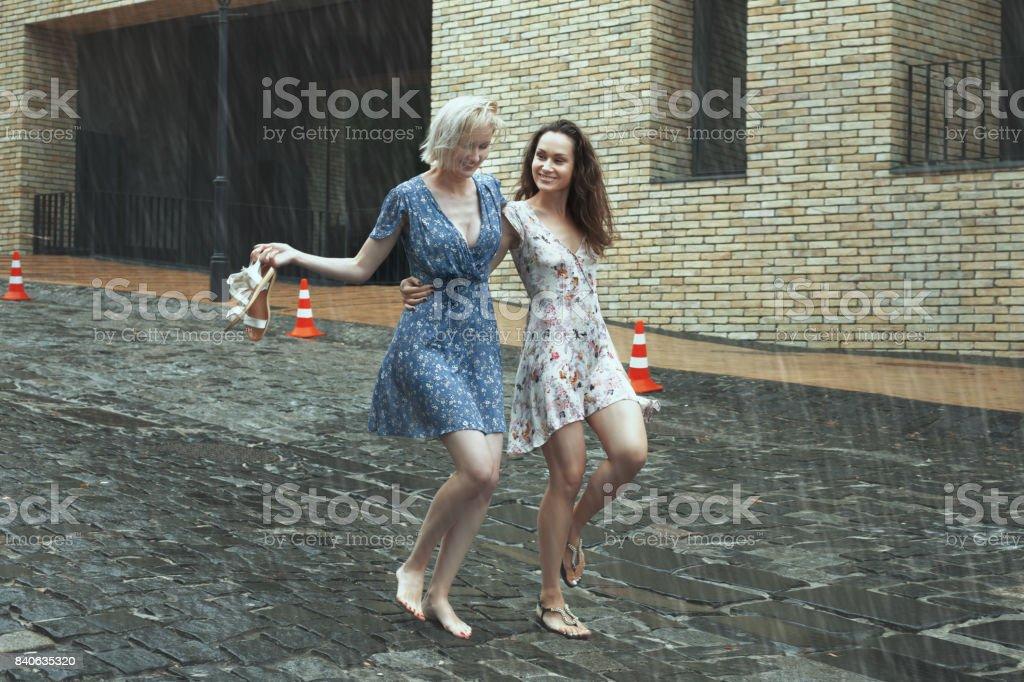 Women in the rain in the city. stock photo