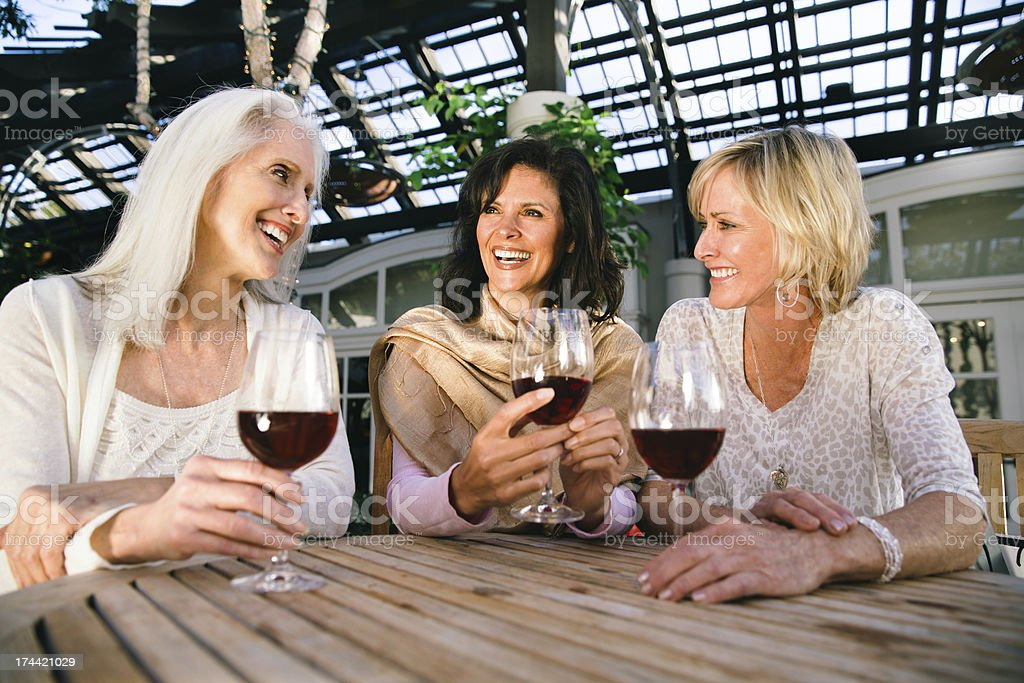 Women in thier 50s-60s drinking wine royalty-free stock photo