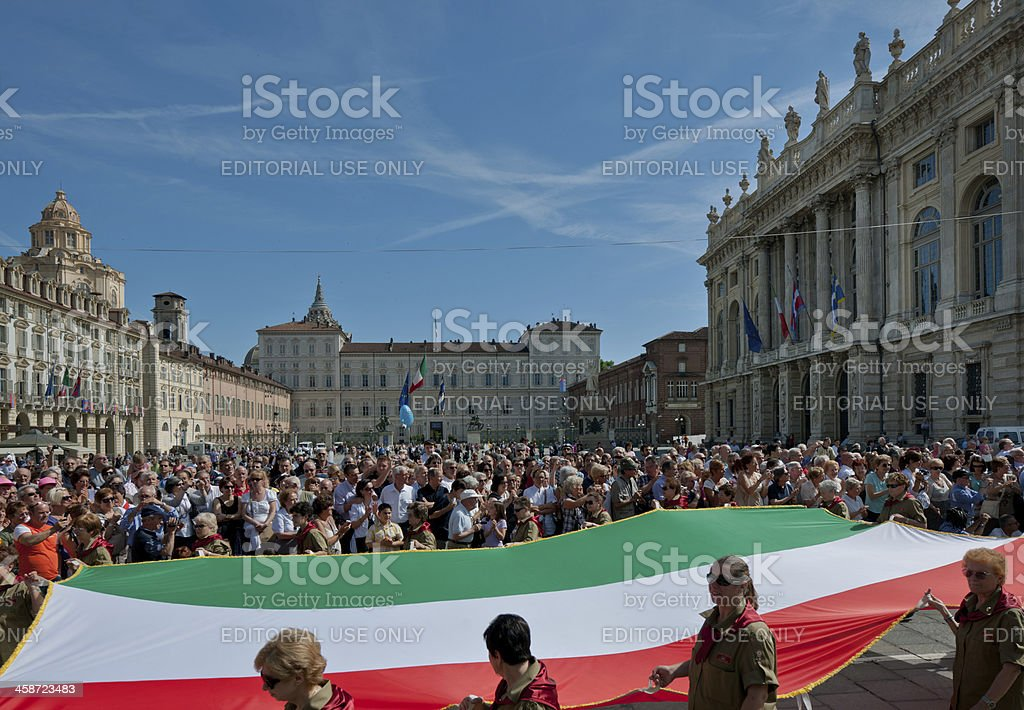 Women in uniform marching with the Italian flag, large crowd royalty-free stock photo