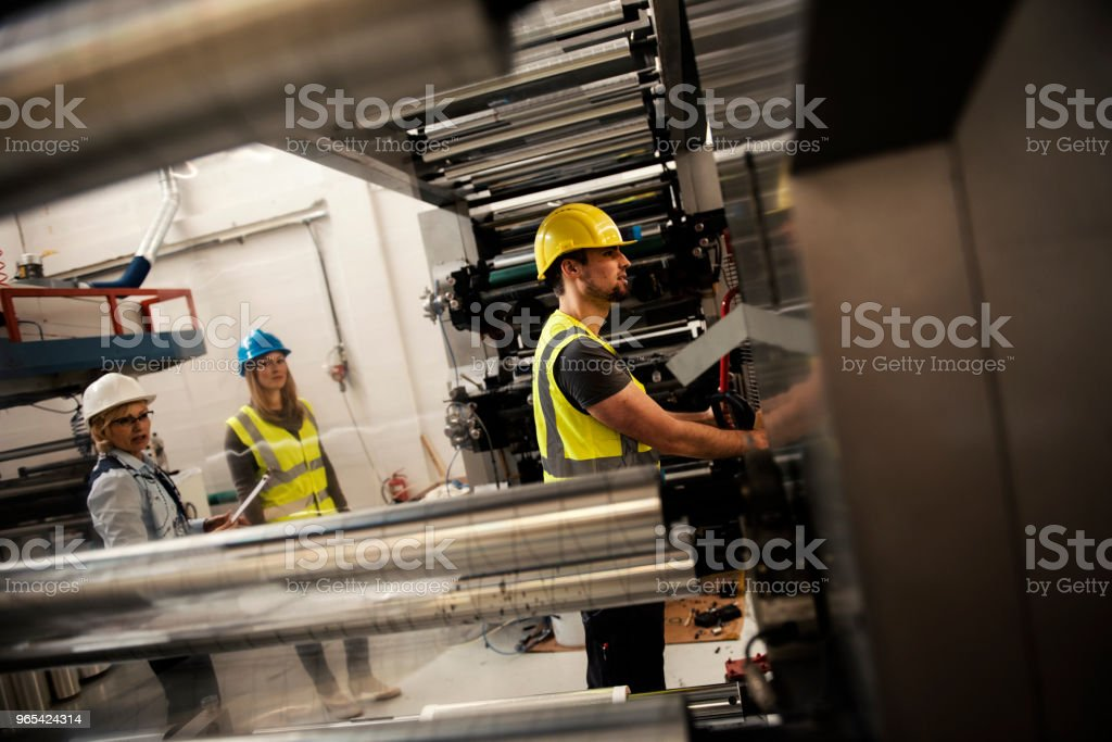 Women inspector checking production line royalty-free stock photo