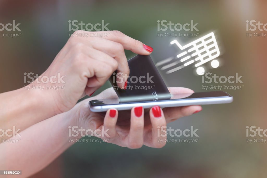 Women is shopping online with mobile phone - foto stock