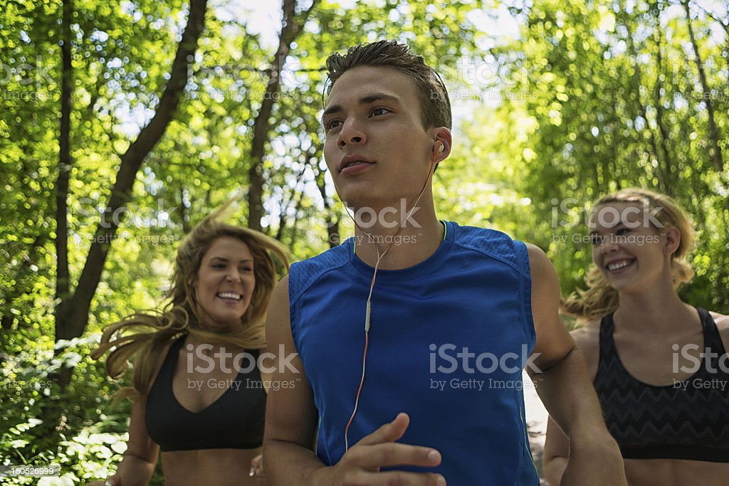 Women Jogging Behind Man royalty-free stock photo