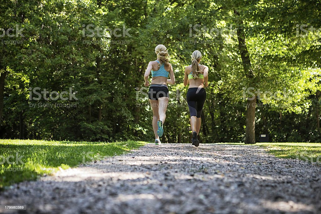 Women Jogging On Gravel Road royalty-free stock photo