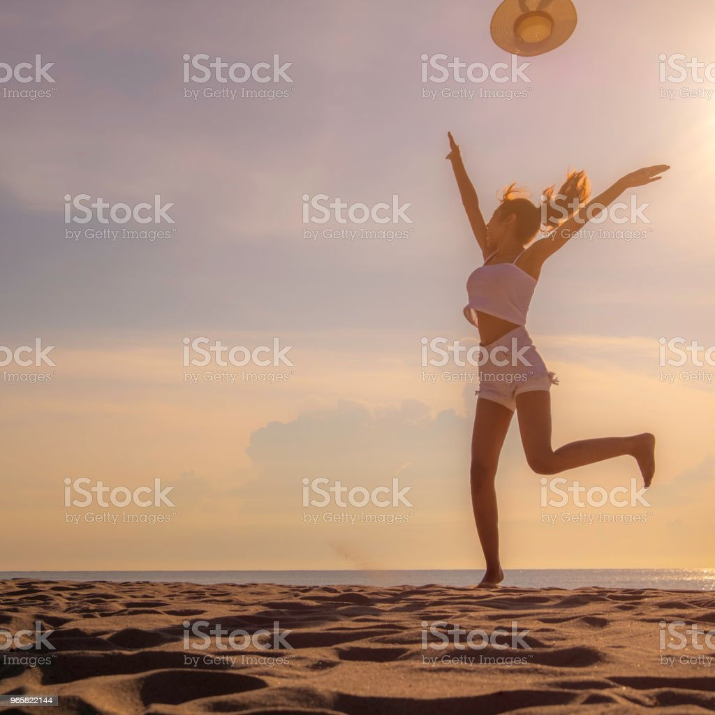 Women jump on the beach with happy acting during sunset with silhouette picture that filling freedom. - Royalty-free Adult Stock Photo