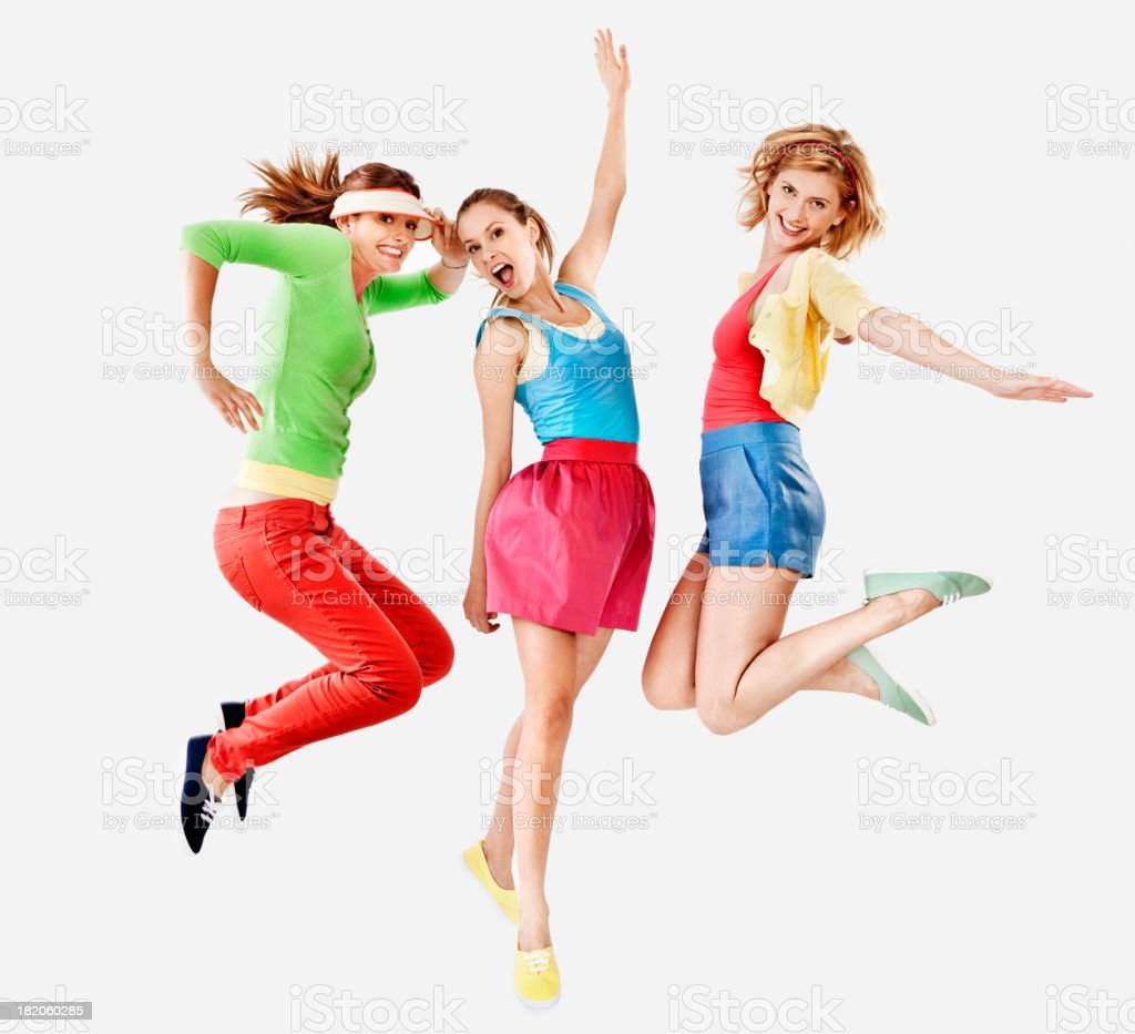 Women jumping with colourful clothes stock photo