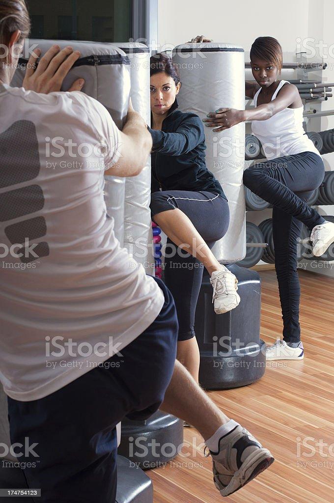 Women KickBoxer with their trainer stock photo