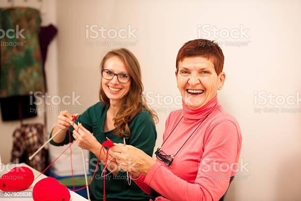 Women knitting with red wool eldery woman transfering knitting picture id507905636?b=1&k=6&m=507905636&s=612x612&h=qq6c1pm0zqp4ssfupeqztl xojdmrejx9dyel ke8lk=