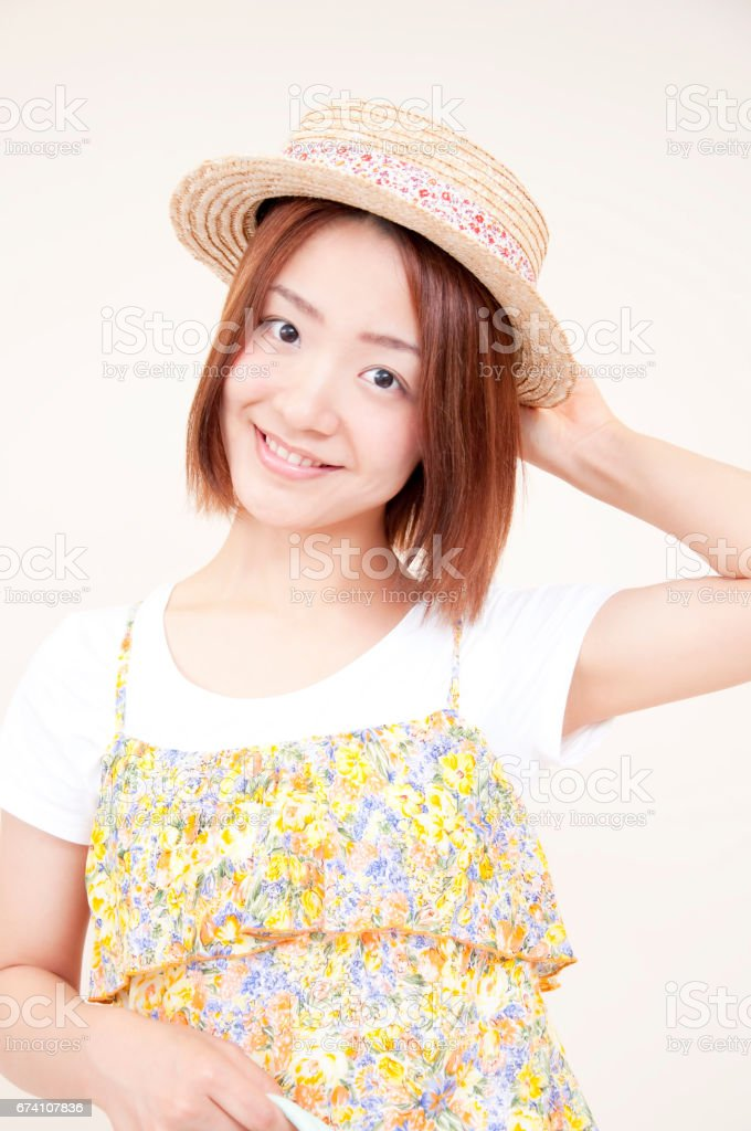 Women laughing and wearing a hat royalty-free stock photo