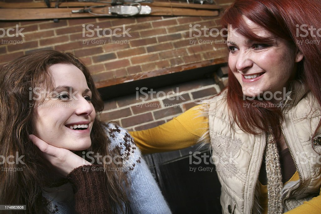 Women Laughing Together at a Ski Lodge royalty-free stock photo
