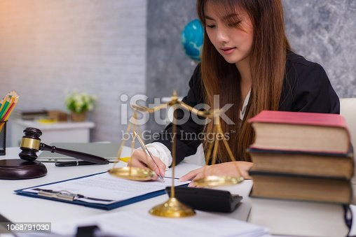1070981872istockphoto Women lawyer working with contract papers and wooden gavel on table in courtroom. justice and law ,attorney, court judge, concep 1068791030
