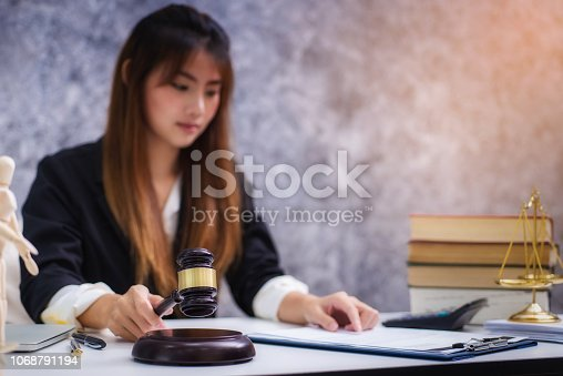 1070981872istockphoto Women lawyer working with contract papers and wooden gavel on table in courtroom. justice and law ,attorney, court judge, concep 1068791194