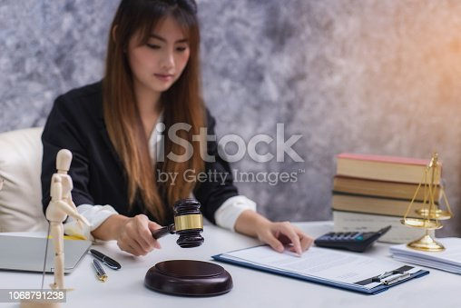 1070981872istockphoto Women lawyer working with contract papers and wooden gavel on table in courtroom. justice and law ,attorney, court judge, concep 1068791238
