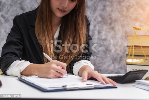 1070981872istockphoto Women lawyer working with contract papers and wooden gavel on table in courtroom. justice and law ,attorney, court judge, concep 1068791290