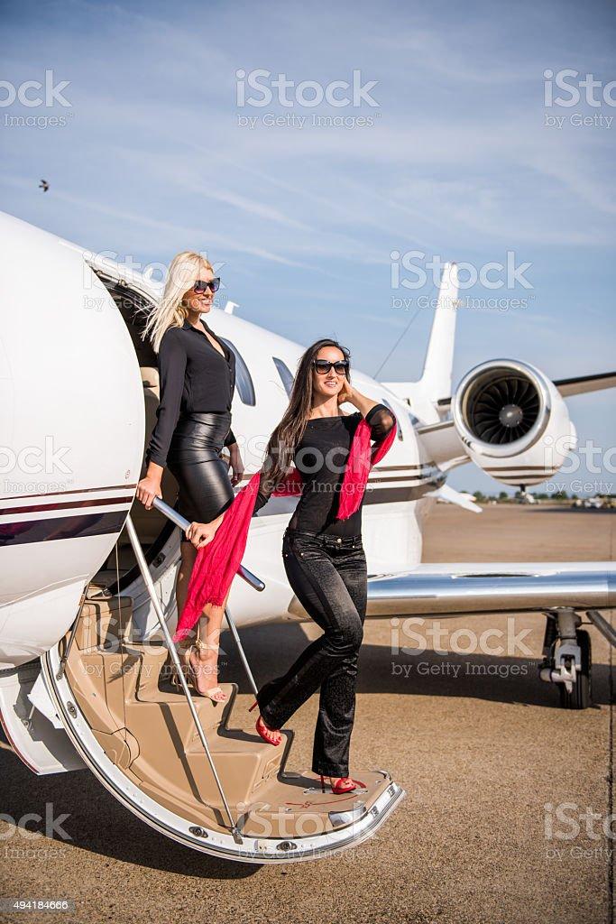 Women leaving the private aeroplane stock photo