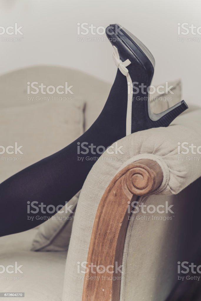 women legs on a vintage seat stock photo