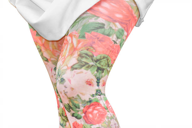 women legs with printed floral leggings isolated - bedruckte leggings stock-fotos und bilder