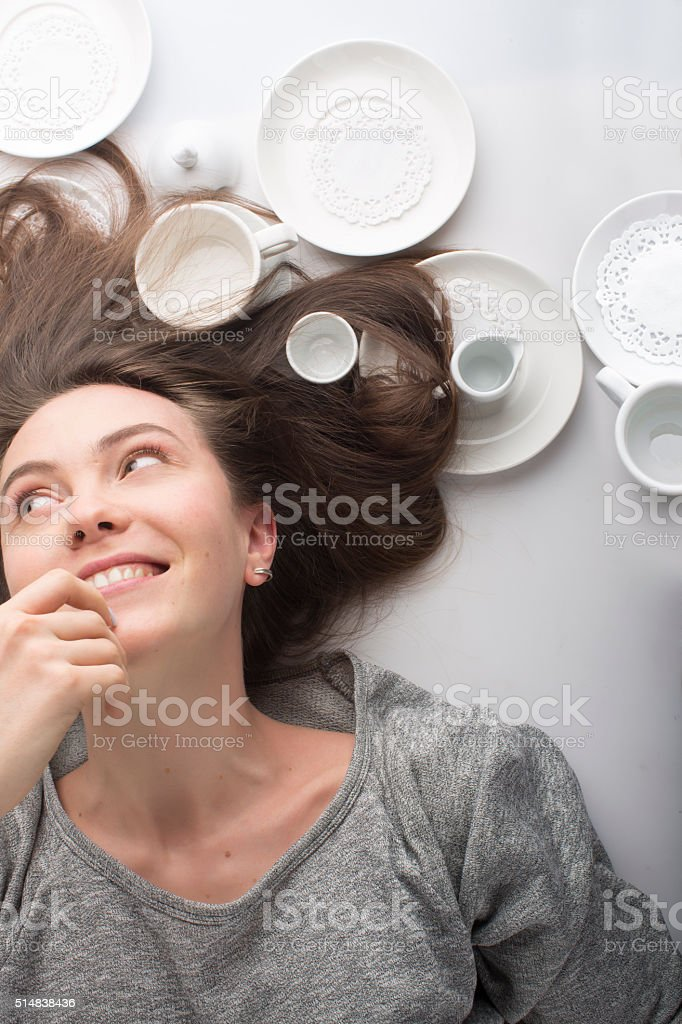 women lies on her back in a white dish stock photo