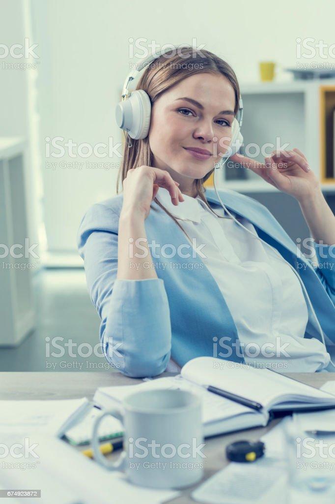 Women listening music on headphones in office royalty-free stock photo