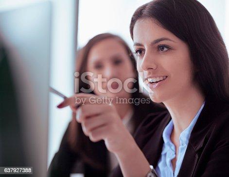 istock Women looking at computer screen in office 637927388