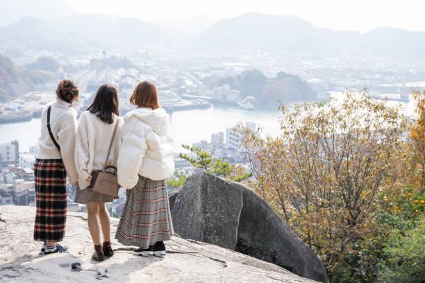Women looking at Onomichi Suido stock photo