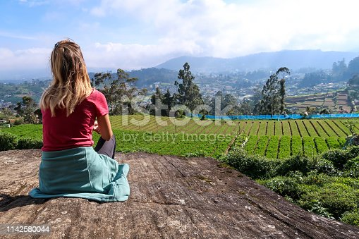 Women looking at fields, Nuwara Eliya, Sri Lanka