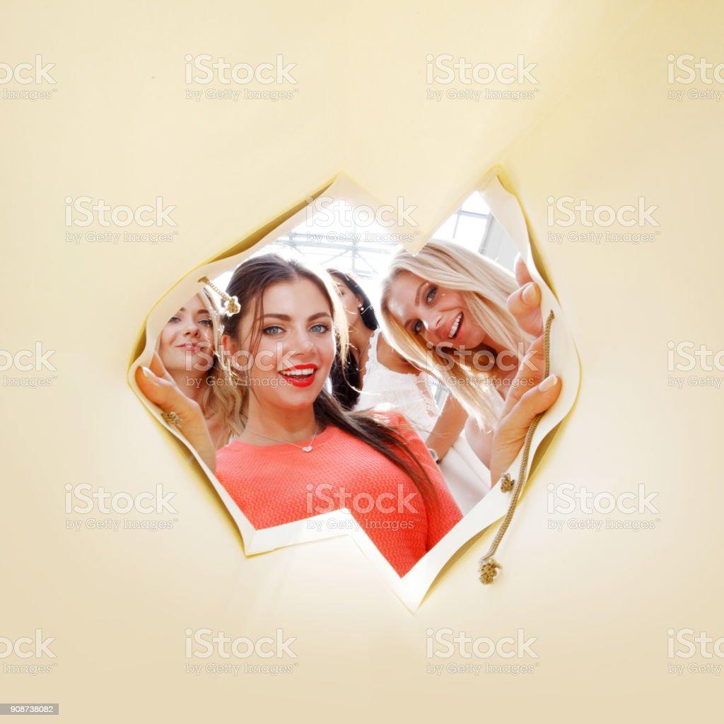 women looking inside bag stock photo