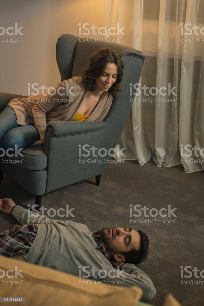 Women looking man who sleeps on floor stock photo