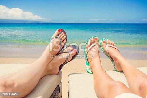 istock Women Lounging and sunbathing on an idyllic beach 509361452