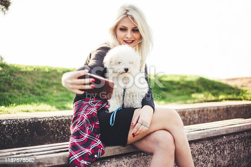 istock Women makes selfie with her dog 1137578562