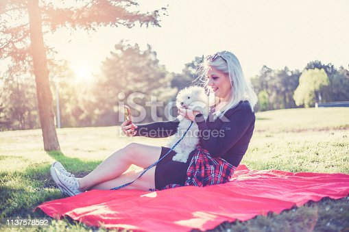 istock Women makes selfie with her dog 1137578592