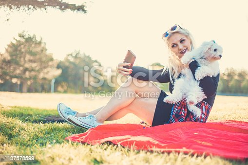 istock Women makes selfie with her dog 1137578599