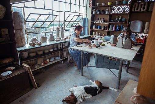 Seniors female potters in art studio