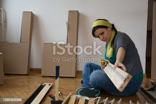 459373065 istock photo Women measuring and searching for the real peace of furniture for folding - Image 1095305368