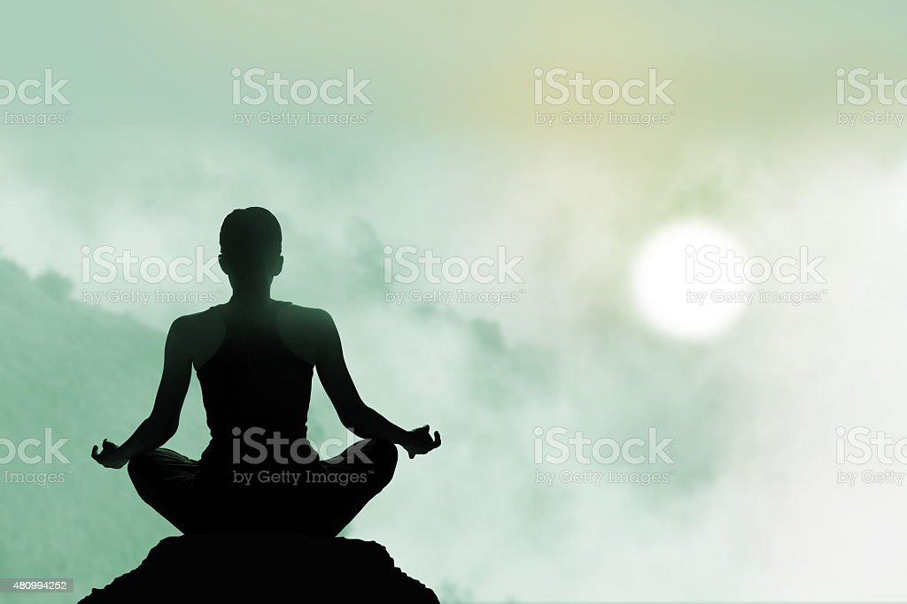 women meditating colorful on high mountain in sunset background stock photo