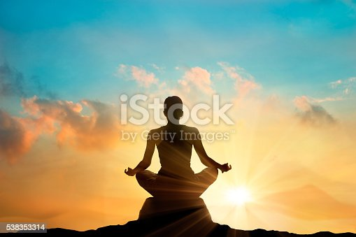 women meditating pastel on high mountain in sunset background