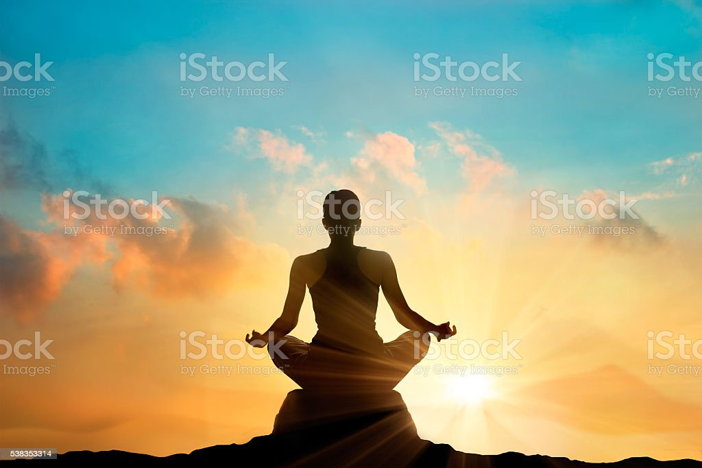 women meditating pastel on high mountain in sunset background stock photo