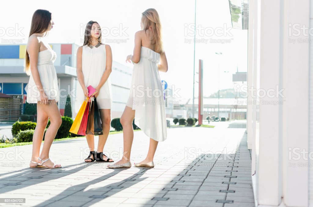 Women meet new friend in shopping mall stock photo