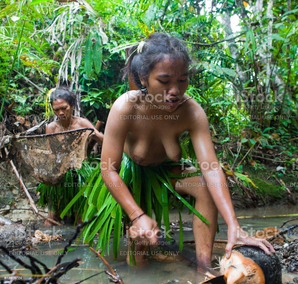 Women Mentawai tribe fishing. stock photo